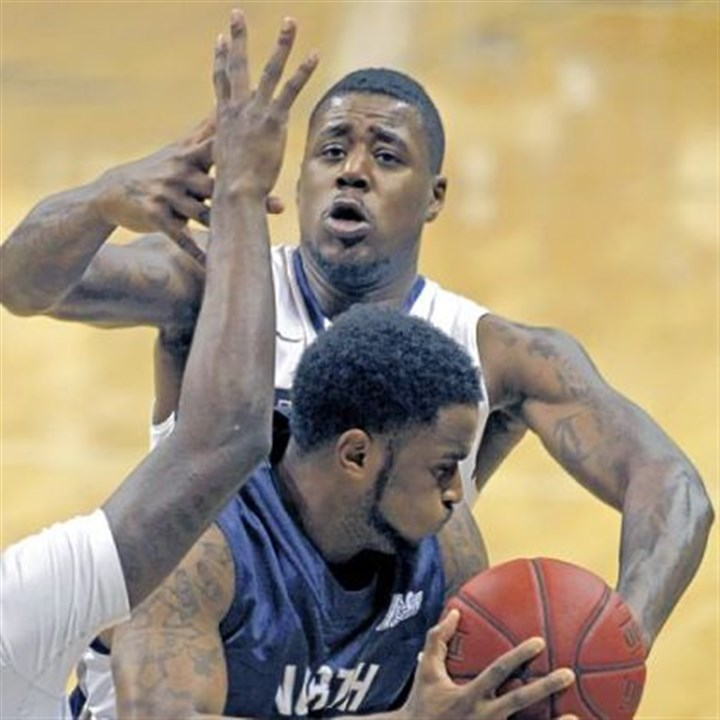 TaylorUNF.jpg Dante Taylor defends North Florida's Travis Wallace in the second half of Pitt's 89-47 win Saturday night.