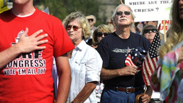 "Tea party in Cranberry From left, Medge Boyer, of Shaler; Paul Jones, of Finleyville, and Juanita Martini, of Elizabeth, recite the Pledge of Allegiance at a ""tea party"" rally at North Boundary Park in Cranberry yesterday afternoon."