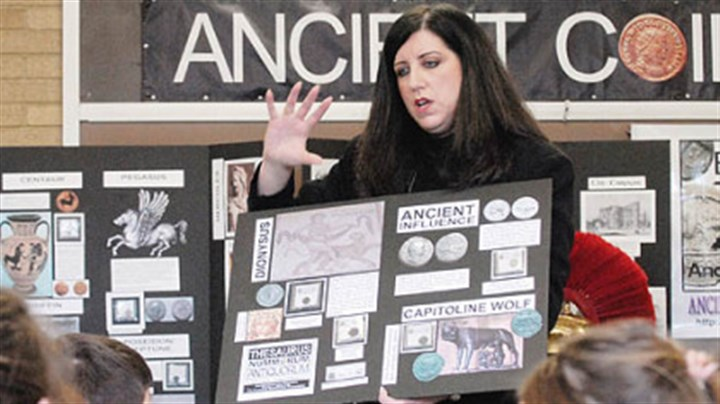 Teaching with coins St. Louise de Marillac teacher Zee Ann Poerio uses the history of ancient coins to help her students with Latin and the history of Rome.