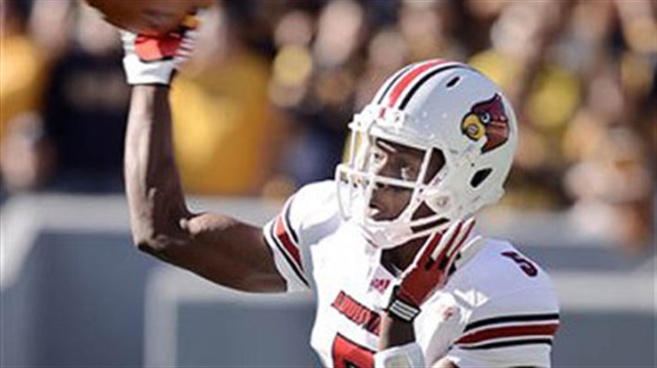 Teddy Bridgewater Louisville quarterback Teddy Bridgewater throws a pass against West Virginia during the first quarter of Saturday's game in Morgantown.