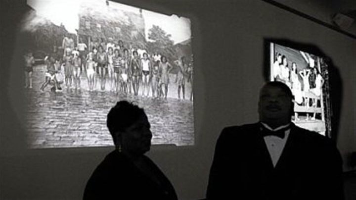 "Teenie Photographs by Charles ""Teenie"" Harris are projected onto the wall at Carnegie Museum of Art as part of ""Teenie Harris, Photographer: An American Story."""