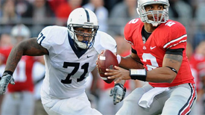 Terrelle Pryor and Devon Still Ohio State quarterback Terrelle Pryor drops back to pass as Penn State's Devon Still closes in in the second quarter.