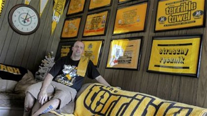 Terrible Bryan Wassel with his large collection of Terrible Towels, in his Irwin home.