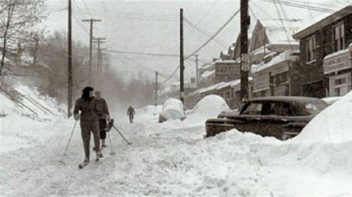 Thanksgiving snowfall of 1950 Skiers make their way along a Squirrel Hill street following the great Thanksgiving weekend snowfall of 1950.