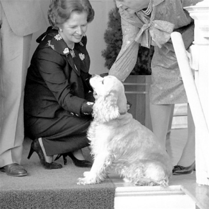 Thatcher British Prime Minister Margaret Thatcher, left, pets the dog belonging to then-Vice President George H.W. Bush and wife, Barbara, right, at the Bush's residence in Washington in September 1983.