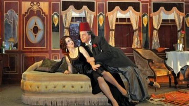 "'The Abduction From the Seraglio' Konstanze, played by Lisette Oropesa, has been ""given"" to Osmin, Paolo Pecchioli, as a gift from the Pasha, but she rebuffs his advances, in the Pittsburgh Opera production of Mozart's ""The Abduction From the Seraglio,"" set on the Orient Express luxury train."