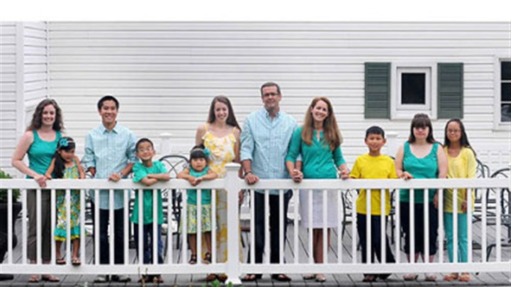 The Clark family The Clark family at their home in McKeesport: From left, Amanda Barney, 28, Annie, 7, Tyler, 18, Travis, 10, Amelia, 4, Amy, 26, parents Tom, 49, and Mary Ellen, 48, Talbot, 10, Abbey, 21, and Alyssa, 18.