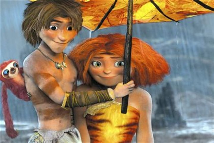 "'The Croods' Ryan Reynolds and Emma Stone provide the voices for Guy, left, and Eep in the animated movie ""The Croods."""