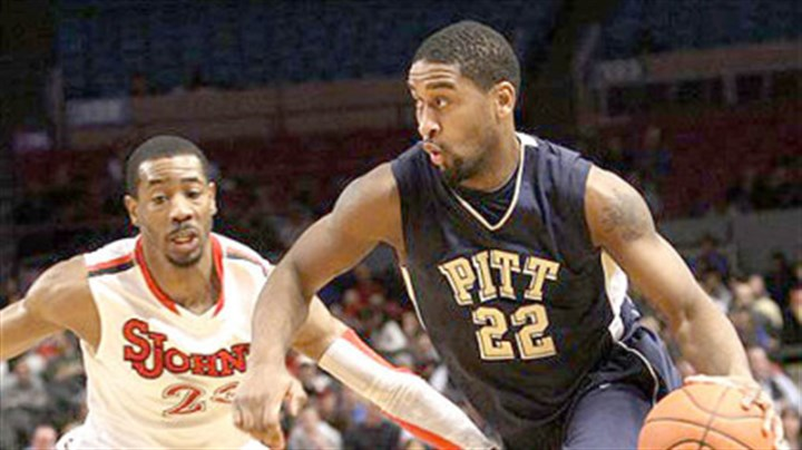 The Drive Pitt's Brad Wanamaker (22) drives past St. John's Justin Burrell during the first half of today's game at Madison Square Garden.