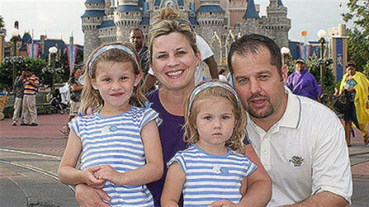 the goretzka family Carrie Goretzka with husband, Michael, and daughters Chloe, left, then 4, and Carlie, then 2, at Disney World in 2009.