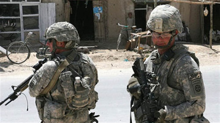 The Guard Sgt. Bryan Hoover, left, and Sgt. Robert Fike, on patrol in the market area of th Shajoy District, Zabul Province, Afghanistan.