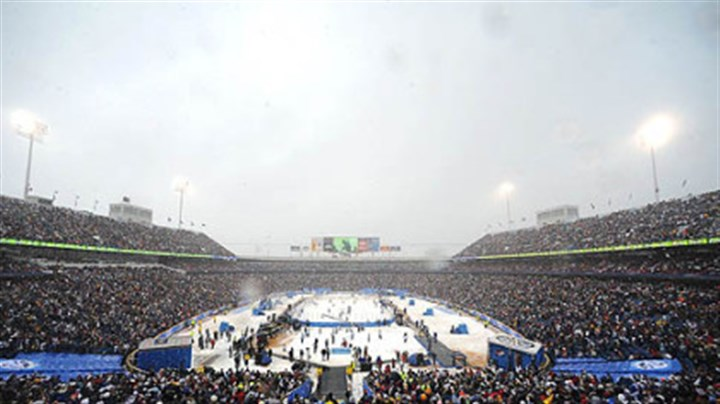 """The Ice Bowl"" A crowd of 71,217 fills Ralph Wilson Stadium to watch the Penguins defeat the Buffalo Sabres, 2-1, yesterday in ""The Ice Bowl."""