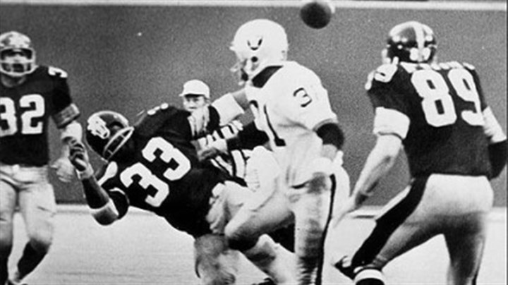 "The Immaculate Reception Franco Harris, far left, sees the ball fly into the air after the Oakland Raiders' Jack Tatum decks the Steelers' Frenchy Fuqua (33), setting up the ""The Immaculate Reception."""