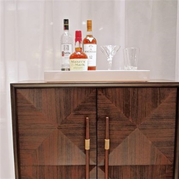 The LaSalle Bar The LaSalle Bar by Mitchell Gold Bob Williams is a versatile piece done in a diamond pattern of Mozambique veneers.