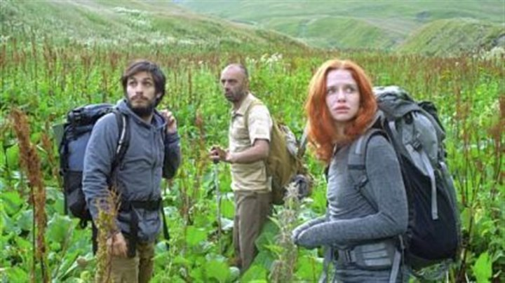 "'The Loneliest Planet' Gael Garcia Bernal and Hani Furstenberg are led through treacherous terrain by mysterious mountaineer Bidzina Gujabidze, center, in ""The Loneliest Planet."""
