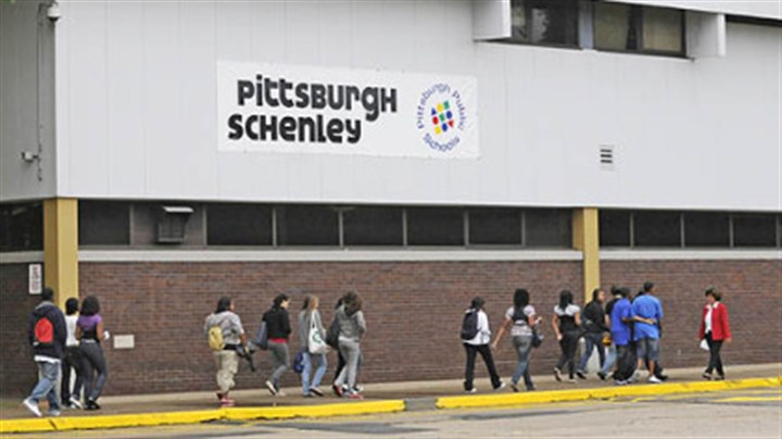 The new Pittsburgh Schenley High School Principal Sophia Facaros, in red jacket, greets students arriving Thursday for the first day of school at the new Pittsburgh Schenley High School, located in the Reizenstein building, Shadyside.