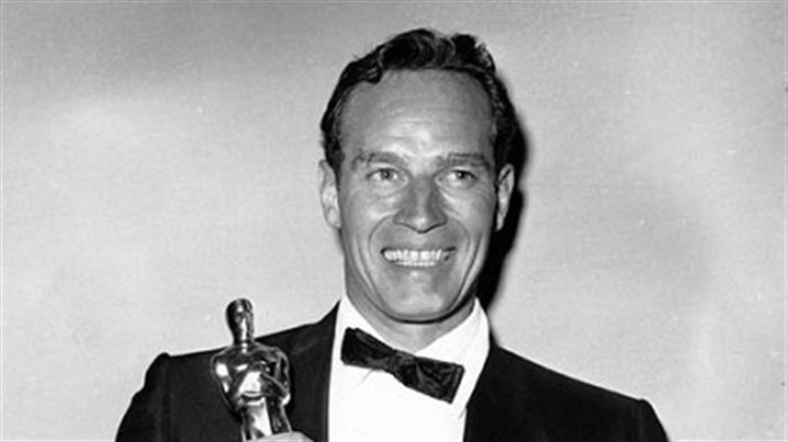 The Oscar for Best Actor Charlton Heston poses with his Oscar statuette at the 32nd Annual Academy Awards held at the RKO Pantages Theater in Los Angeles, Ca. on April 4, 1960.