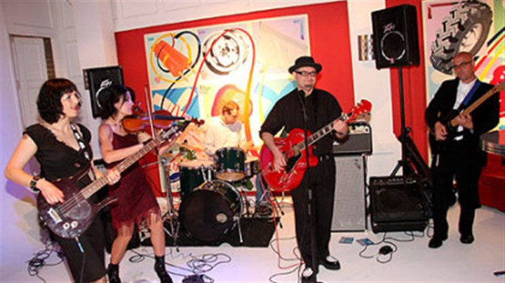 The Whips The Whips, a Pittsburgh band, provided the music for the ToonSeum's Ka-Blam!