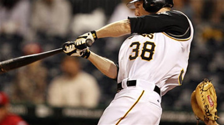 The winning home run Pirates' Jason Bay hits a solo home run off of Cincinnati Reds' pitcher Jared Burton during the sixth inning of their rain delayed baseball game last night at PNC Park. The Pirates went on to win, 1-0.