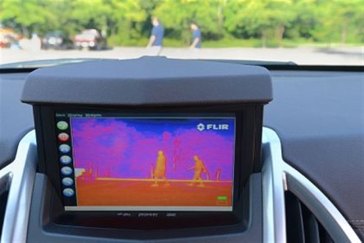 Thermal infrared camera Mounted on the dashboard of the computer-driven Cadillac is a thermal infrared camera used to help the car categorize the objects in its path.