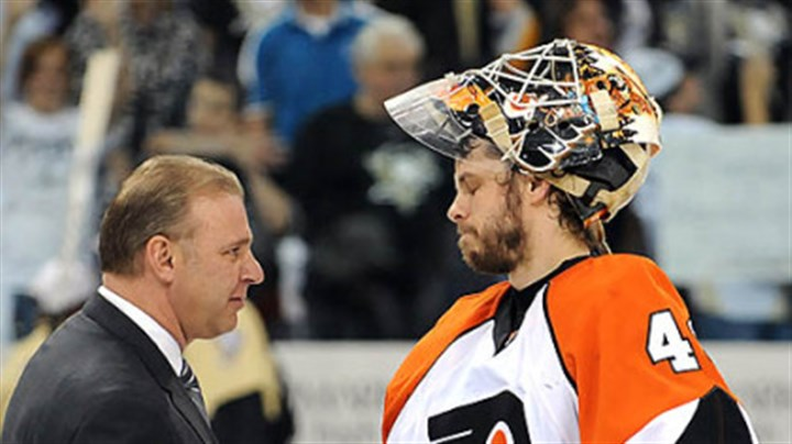 Therrien Penguins head coach Michel Therrien shakes hands with Flyers goalie Martin Biron.
