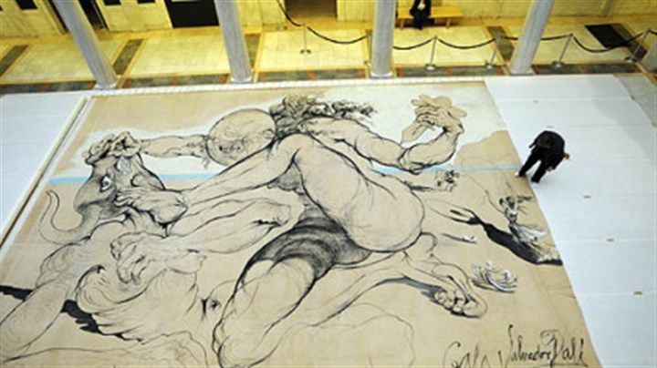 "Theseus Minotaur A Salvador Dali work; a 1942 curtain ""Theseus Minotaur,"" for the Ballet Russe de Monte Carlo is inspected by Ellen Baxter, chief conservator at the Carnegie Museum of Art."