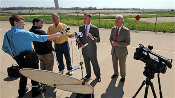 Tim Murphy and Jack Wagner answer questions U.S. Rep. Tim Murphy, center, and state Auditor General Jack Wagner, right, answer reporters' questions after a tour of the 911th Airlift Wing Air Force Reserve Base at the Pittsburgh International Airport. The two continue to seek information from the Air Force on why the base has been selected for closure.