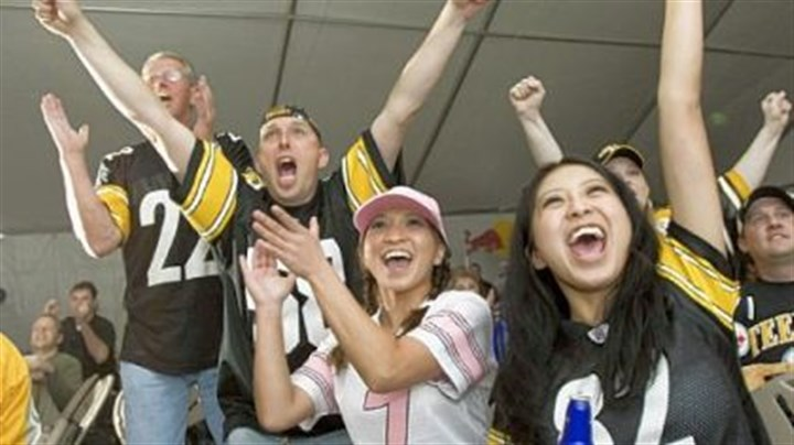 Time travel Peoria, Ariz., residents, from left, Bud Gay, Mike Lang, Kristy Lang and Cyndy Mangahas cheer on the Steelers at Harold's Cave Creek Corral in Cave Creek, Ariz., during the AFC championship game against the Denver Broncos on Jan. 22, 2006.