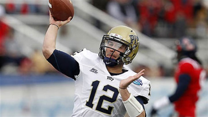 TinoWarmup.jpg Pitt quarterback Tino Sunseri warms up before the BBVA Compass Bowl against Mississipi.