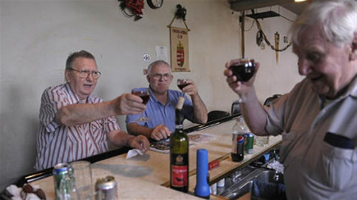 Toast with Hungarian wine From left, Steve Gergery of Cheswick, Janos Kerekgyarto of Hazelwood and Frank Petohazi of Munhall toast on Friday with Hungarian wine on the last day of the Hungarian club in Hazelwood.