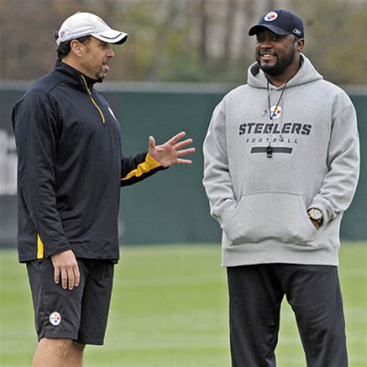 Todd Haley and tomlin Steelers offensive coordinator Todd Haley talks with head coach Mike Tomlin during practice at the team''s South Side Facility.