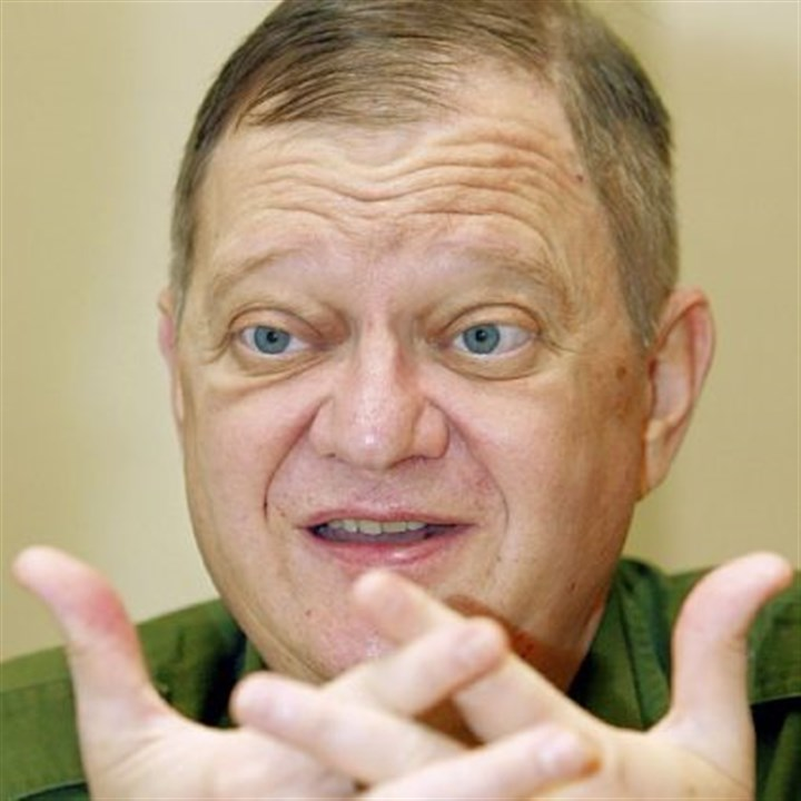 "Tom Clancy gestures Author Tom Clancy gestures during an interview in 2004 in New York. Mr. Clancy, the bestselling author of ""The Hunt for Red October"" and other wildly successful technological thrillers, has died at age 66. Penguin Group (USA) said Wednesday that Mr. Clancy died Tuesday in Baltimore. The publisher did not disclose a cause of death."