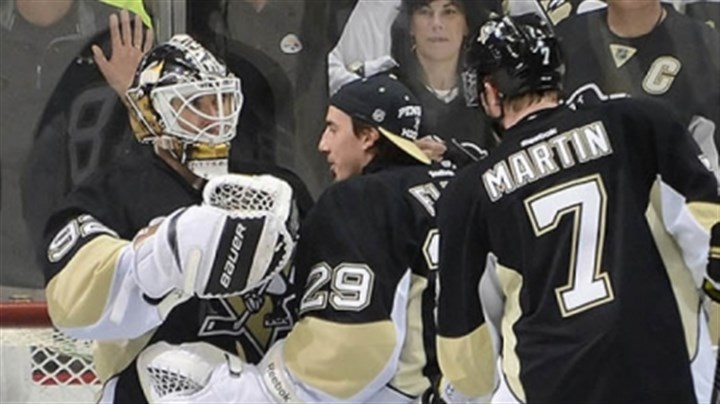 Tomas Vokoun with Marc-Andre Fleury and Paul Martin Goalie Tomas Vokoun, left, celebrates with Marc-Andre Fleury and Paul Martin after the 4-0 victory against the Islanders.