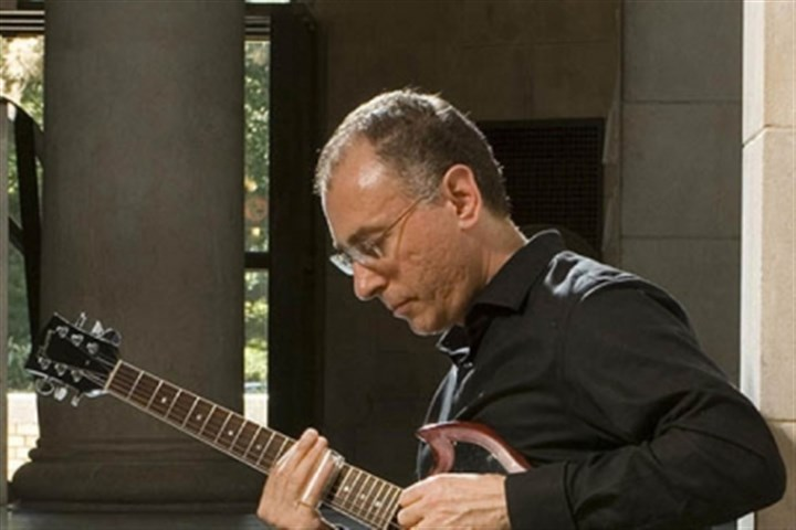 Tonight_Guitarist Guitarist and college professor John Marcinizyn will be performing at Downtown's Fairmont hotel starting at 7:30 tonight.