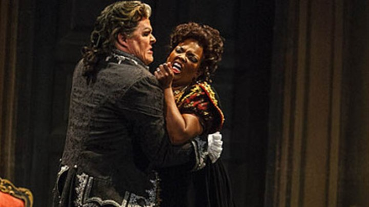 "Tosca Anglea Brown as Tosca ""has a luscious, full-bodied sound ... the fire and ice of a genuine diva."" Mark Delavan as Scarpia is ""suave and menacing"" with a ""booming baritone"" that ""makes the right dramatic points."""