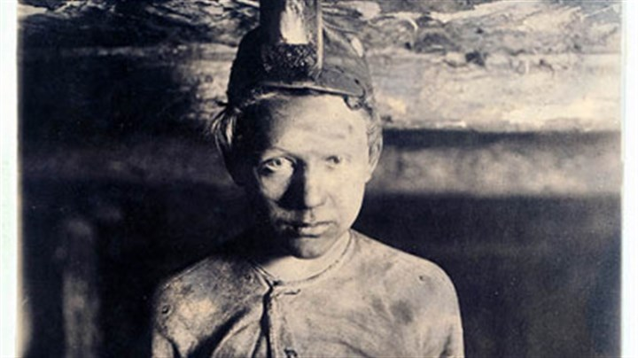 Trapper Boy This circa 1908 photograph shows a trapper boy at Turkey Knob Mine in Macdonald, W.Va. Trapper boys were paid 85 cents a day in Monongah, W.Va., to operate the wooden ventilation doors known as traps that controlled the flow of air inside the mines.