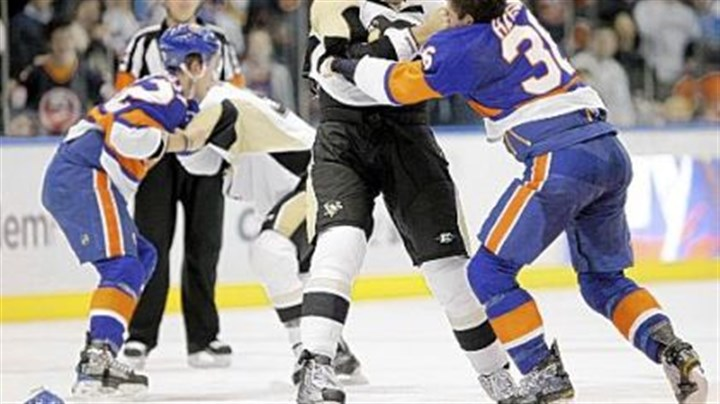 Travis Hamonic and Michael Rupp The Penguins' Michael Rupp and the Islanders' Travis Hamonic fight Friday night in Uniondale, N.Y. It was one of many.