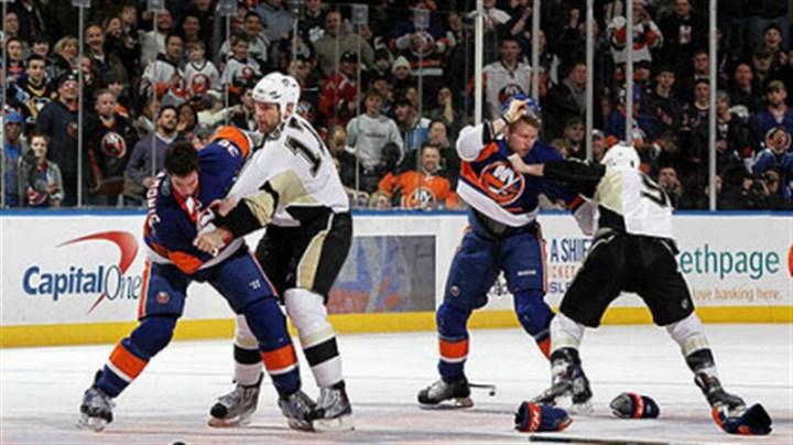 Travis Hamonic, Mike Rupp, Josh Bailey and Pascal Dupuis Islanders defenseman Travis Hamonic fights Penguins forard Mike Rupp (left) of as Islanders forward Josh Bailey battles Pascal Dupuis during the second period of Friday's game at Nassau Coliseum.