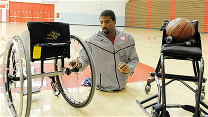 Trevon Jenifer wheelchair basketball 2 Trevon Jenifer, a 24-year-old graduate of Edinboro University, switches the wheels from his everyday wheelchair to the one he uses for basketball. The game chairs are custom-built to regulation specifications for each player depending on their size and style of play.