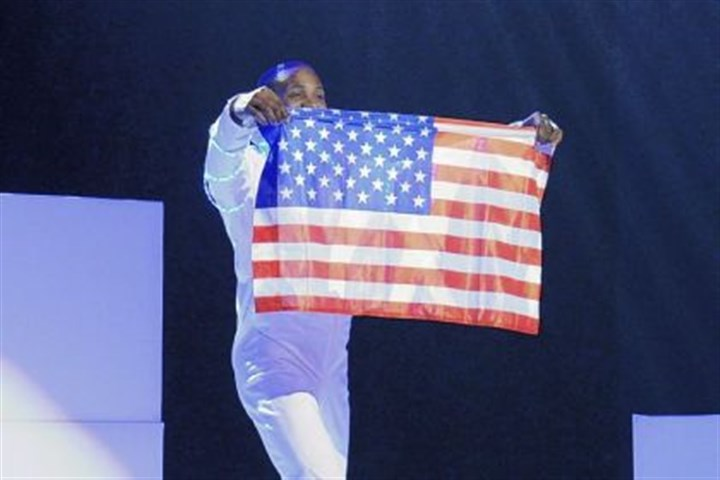 "Trey Richardson On ""America's Got Talent,"" Trey Richardson wrapped up SensEtion's performance by holding an American flag. However, the group's performance didn't pass muster with enough of the judges."