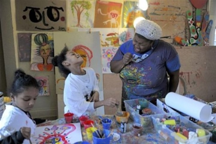 Trinity Reynolds, Tori Hammond and Vanessa German Trinity Reynolds, 6, left, paints while Tori Hammond, 8, center, laughs as artist Vanessa German sings at the Art House in Homewood.