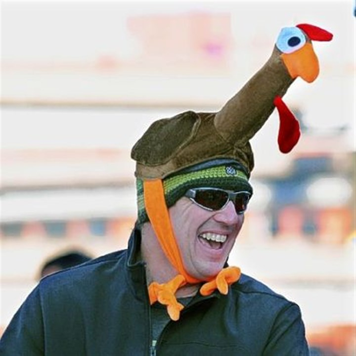 Trot support Glenn Gallacher of Mount Washington watches his wife run in the Turkey Trot.