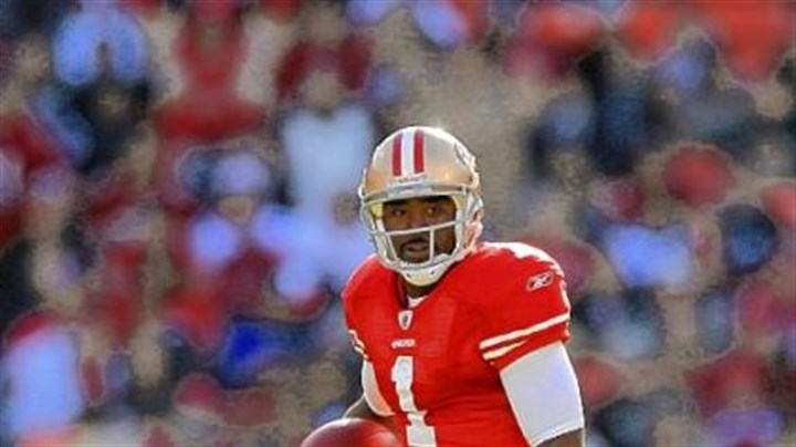 Troy Smith Troy Smith of the San Francisco 49ers runs with the ball against the Tampa Bay Buccaneers during a Nov. 2010 game at Candlestick Park.