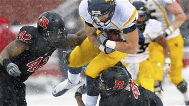 Tyler Urban West Virginia's Tyler Urban tries to split two Rutgers defenders Saturday in the snow of Piscataway, N.J.