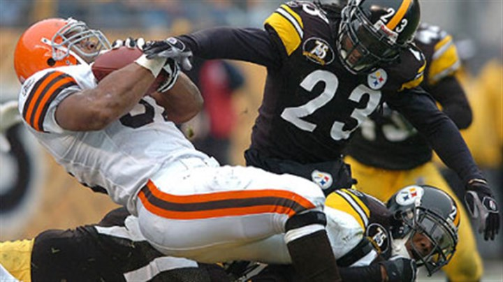 Tyrone Carter and Browns Jamal Lewis Defensive back Tyrone Carter makes the hit on Browns running back Jamal Lewis. (vs. Browns 11/11/07)