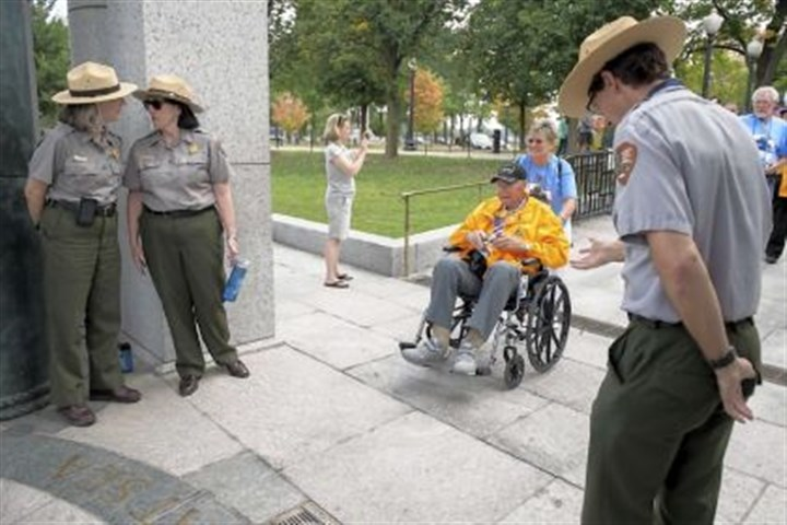 U.S. Park Rangers Park Rangers welcome Korean War veteran Howard Schrowang to the World War II Memorial in Washington, D.C. Following the example set Tuesday by a group of fellow veterans from Mississippi, Honor Flights from Missouri, Illinois and Michigan entered the closed memorial past a blockade erected because of the government shutdown.