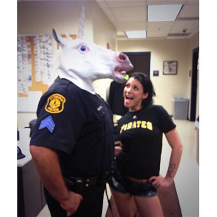 unidentified city police sergeant An unidentified city police sergeant, who is facing possible discipline, wears a unicorn mask next to Andy Sam Dimas, a porn star who had just been thrown out of a Pittsburgh Pirates game for dancing in the mask.