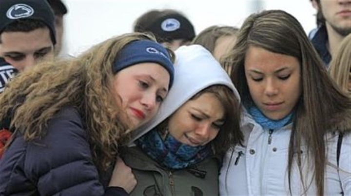 university park somber penn state paterno From left, Annelise Gaus of Wexford, Meredith Moore of Doylestown, Pa., and Tanya Cuadra of Rockville, Md., comfort each other Sunday at a memorial for coach Joe Paterno at his statue outside Beaver Stadium. The young women, who sung the alma mater at the memorial, are part of the Penn State Singing Lions.