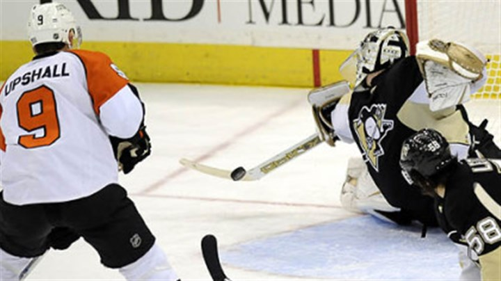 Upshall Penguins Marc-Andre Fleury makes a save on Flyers Scottie Upshall late in the third period Sunday.