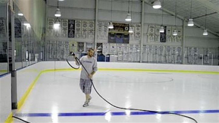 Valley Sports Complex Chadd John of Lower Burrell does some regular ice maintenance Thursday at the Valley Sports Complex. The Sports Complex is expecting some upgrades in the near future, including new lighting and signage.